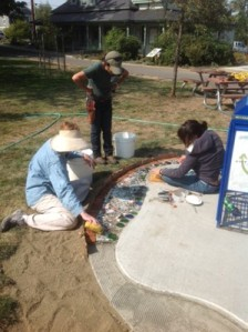 volunteers helping with the Recology mosaic at North Mountain Park Ashland