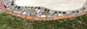 Glass, metal, keys, bike parts, bricks, tiles, stones, all reused to create a mosaic in  North Mountain Park